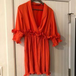 Fun and frilly orange dress